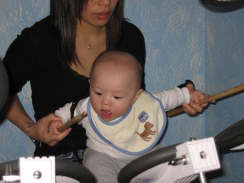 Sharon_and_baby_on_drums